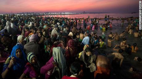 Hindus take a dip in Prayagraj, where Ganges, Yamuna and Sarasvati rivers meet.
