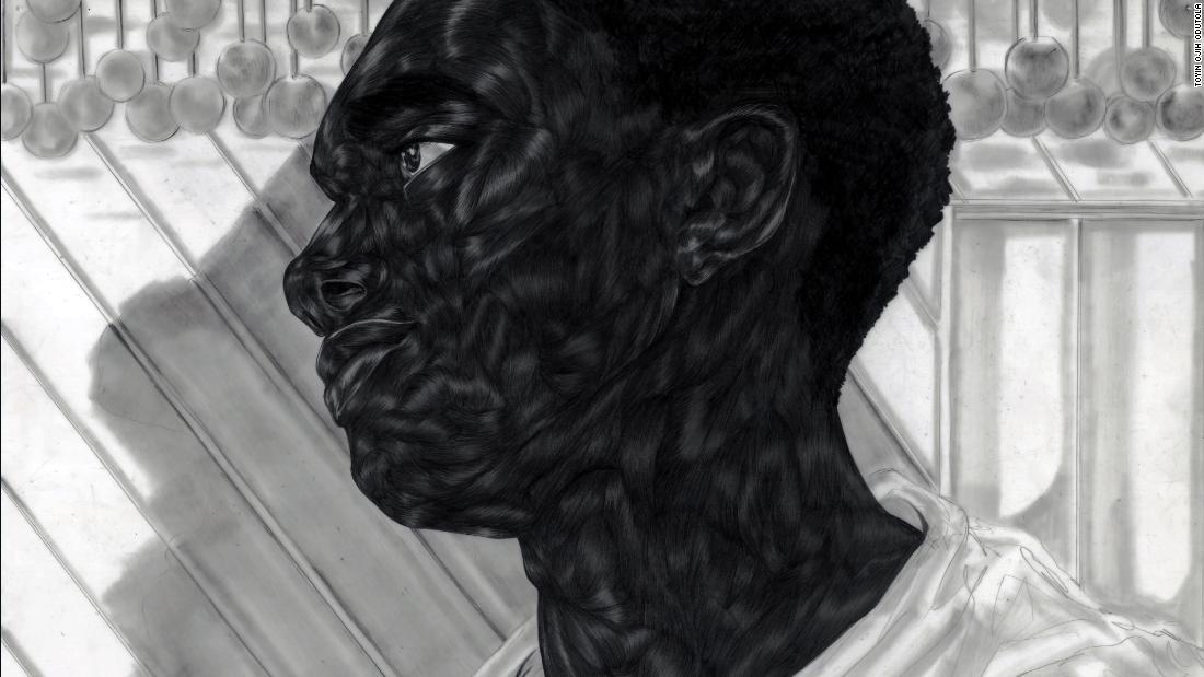Photo of Artist Toyin Ojih Odutola drawing complex portraits of black life