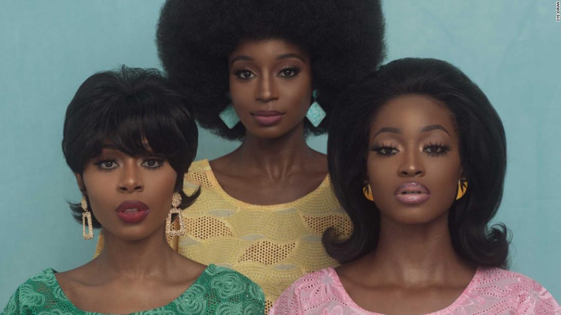 Nigerian photographer embracing in vintage Yoruba style