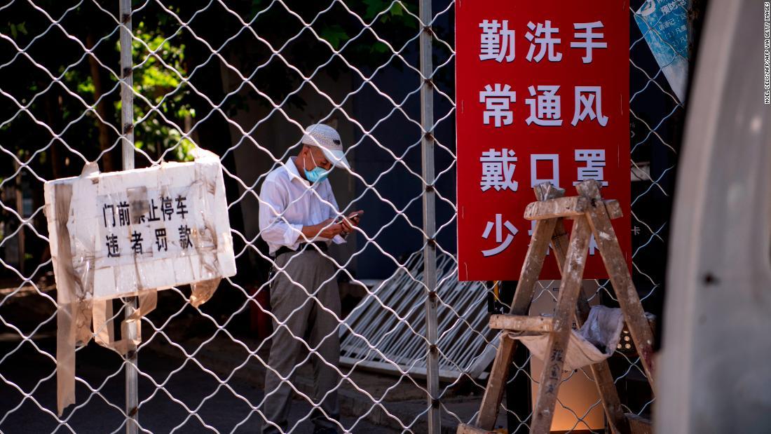 Beijing reintroduces strict lockdown following new outbreak