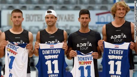Borna Coric, Grigor Dimitrov, Novak Djokovic and Alexander Zverev (left to right) pose for a group shot before an exhibition basketball game in Zadar, Croatia.