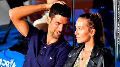 Serbian tennis player Novak Djokovic (L) talks with his wife Jelena on June 14, 2020 during a match played at the Novak Djokovic Balkans charity tennis tournament in Belgrade.