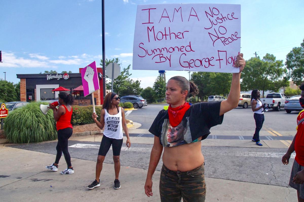 Unarmed black man shot dead by Atlanta cops by Atlanta cops