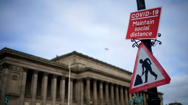 LIVERPOOL, ENGLAND - OCTOBER 08: A social distancing sign is affixed next to Saint George's Hall on October 08, 2020 in Liverpool, England. It has been reported that a three-tier lockdown system, similar to a traffic light system is being contemplated by the British government to simplify coronavirus (Covid-19) lockdown measures. (Photo by Christopher Furlong/Getty Images)